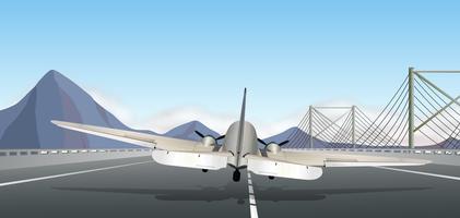 Rygg på flygplan som landar på landningsbanan