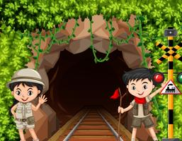 Boy and girl scout in front of tunnel