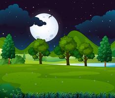 Escena nocturna con luna llena en el parque