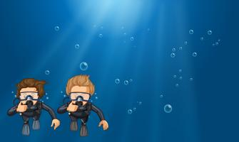 Scene with two scuba divers underwater