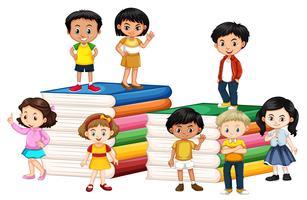 Happy children standing on books