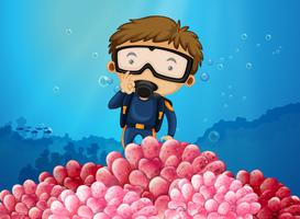 Mergulhador mergulhando sob o oceano