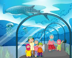 Muslim people visiting aquarium