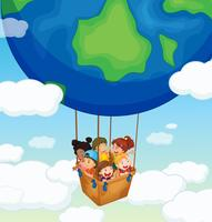 Happy kids riding on big balloon