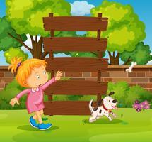 Holzschild und Mädchen im Park