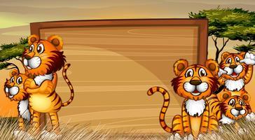 Plantilla de marco con tigres en el campo.