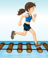 Girl running on wooden log bridge