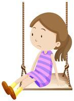 Little girl on wooden swing