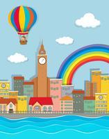 Hete luchtballon die over de stad vliegt