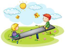 Dos niños jugando en balancín en el parque