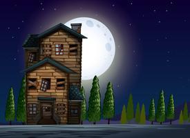 Gamla trähus på fullmoon natt