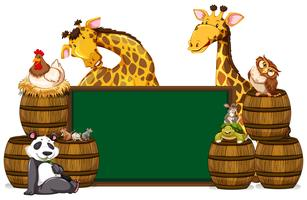 Green board with giraffes and other animals