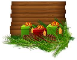 Holzbrett mit Geschenken und Blättern