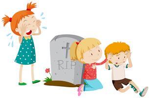 Tres niños tristes junto a la tumba.