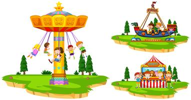 Children playing on rides in the park vector