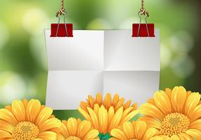Papier blanc avec des fleurs en arrière-plan