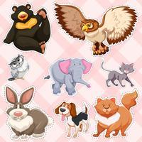 Diseño de pegatinas para animales salvajes sobre fondo rosa.