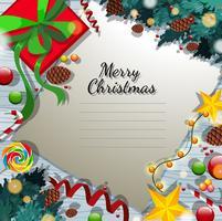 Modelo de cartão de feliz Natal com presentes e ornamentos