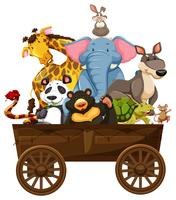 Many wild animals on wooden wagon