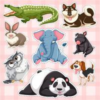 Conjunto de adhesivos para animales salvajes sobre fondo rosa.