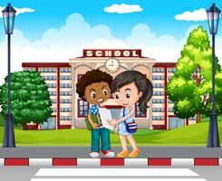 Two kids in front of the school