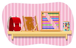 Schoolbag and abacus on shelf