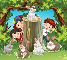 Children in the jungle with rabbits