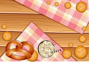 Pretzel and crackers on wooden board