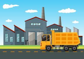 Escena de la fábrica con camión de descarga