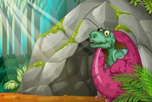 Dinosaur kläckande ägg framför grottan