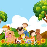 Children and pet dogs in garden
