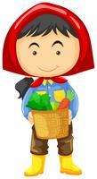 Female farmer holding basket of vegetables