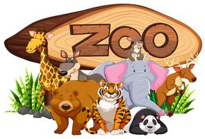 Wild animals by the zoo sign