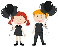 Boy and girl holding black balloons