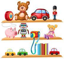 Muchos juguetes y libros en estantes de madera.