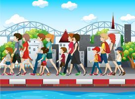 Mensen lopen op de stoep in de stad
