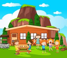 Scene with kids having picnic by the cottage vector