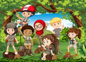 Many children hiking in the forest