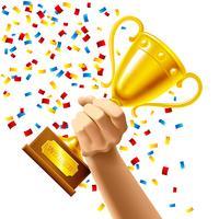 Hand som håller en vinnare trofé cup pris