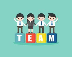 Geschäftsleute, die auf Block stehen und Hand, Teamwork-Konzept halten