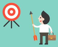 Businessman holding arrow and look at target determined to reach his goal