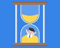 Empresario inundado en reloj de arena, concepto de gestión del tiempo