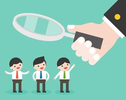 Hand hold magnify glass with group of cute businessman