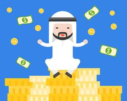 Cute Arab businessman sitting on pile of gold coins , business situation rich