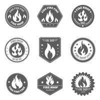 Feuer-Shop-Emblem-Ikonen schwarz eingestellt
