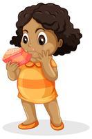 Linda garota comendo bolo