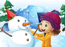 Linda garota e boneco de neve na frente do iglu