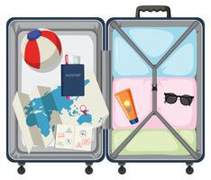 Modern resväska med reseobjekt