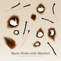 Papel con agujeros quemados y fósforos