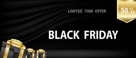 Black Friday with gifts on black curtain and stage background